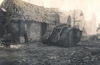 The destroyed and abandoned tank Conqueror II C47, in the Rue de la Liberté. The ruins of the church can be seen at the end of the street.